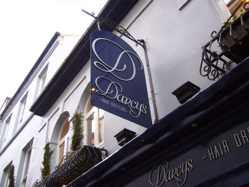 Darcys ornate hanging projection sign