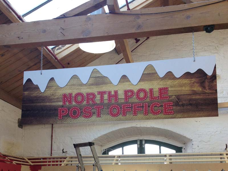 North pole seasonal hanging sign