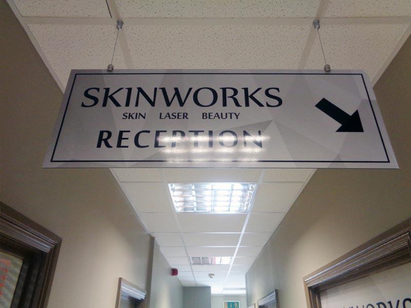 Skinworks hanging dibond sign
