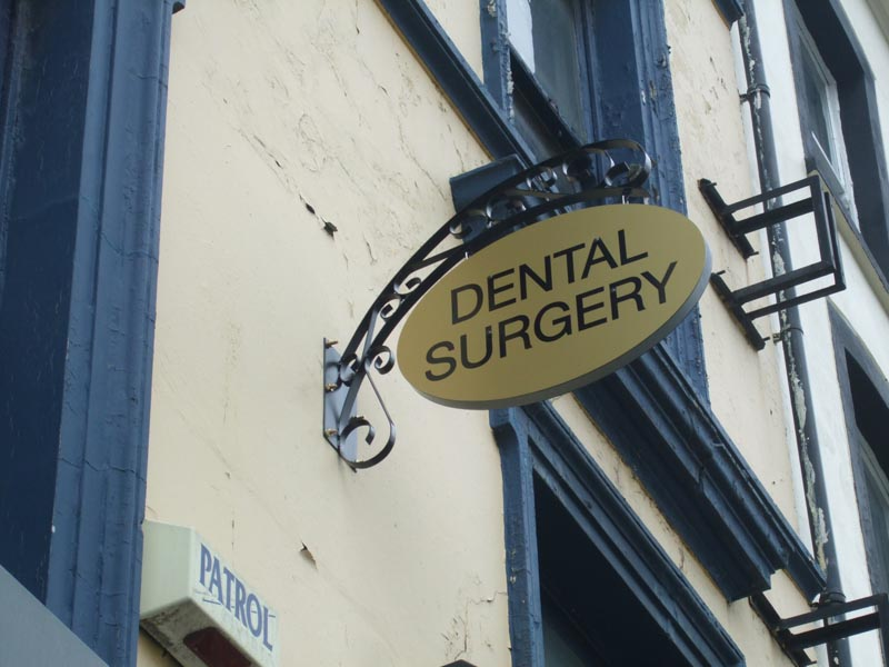 dental surgery - ornate projection sign